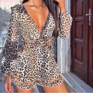 Animal print romper . Cut out on sides!